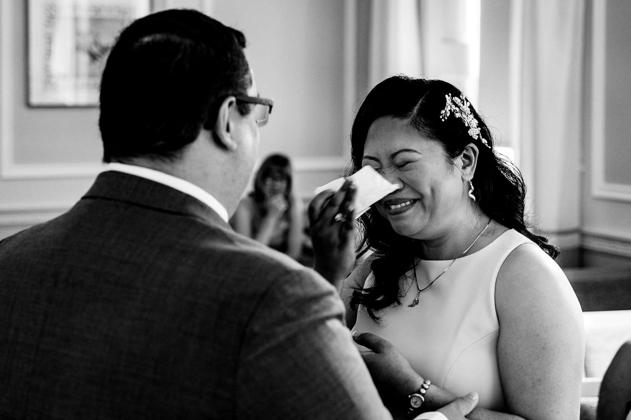 A bride crying during her wedding ceremony at Basingstoke Registry Office