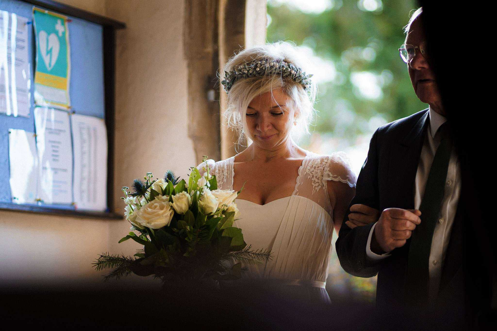 A bride enters the church with her father