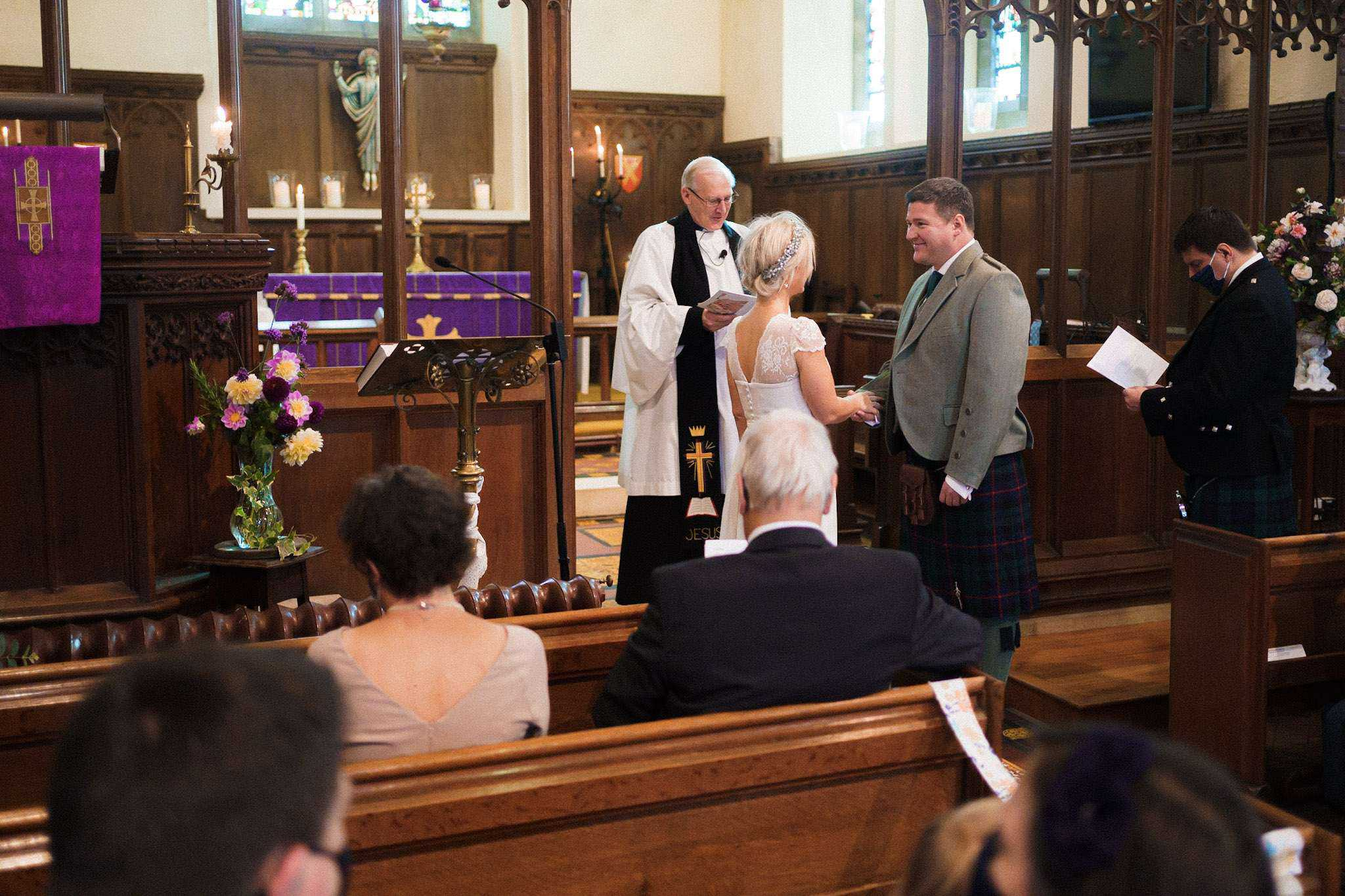 A bride and groom share their vows with each other during the ceremony