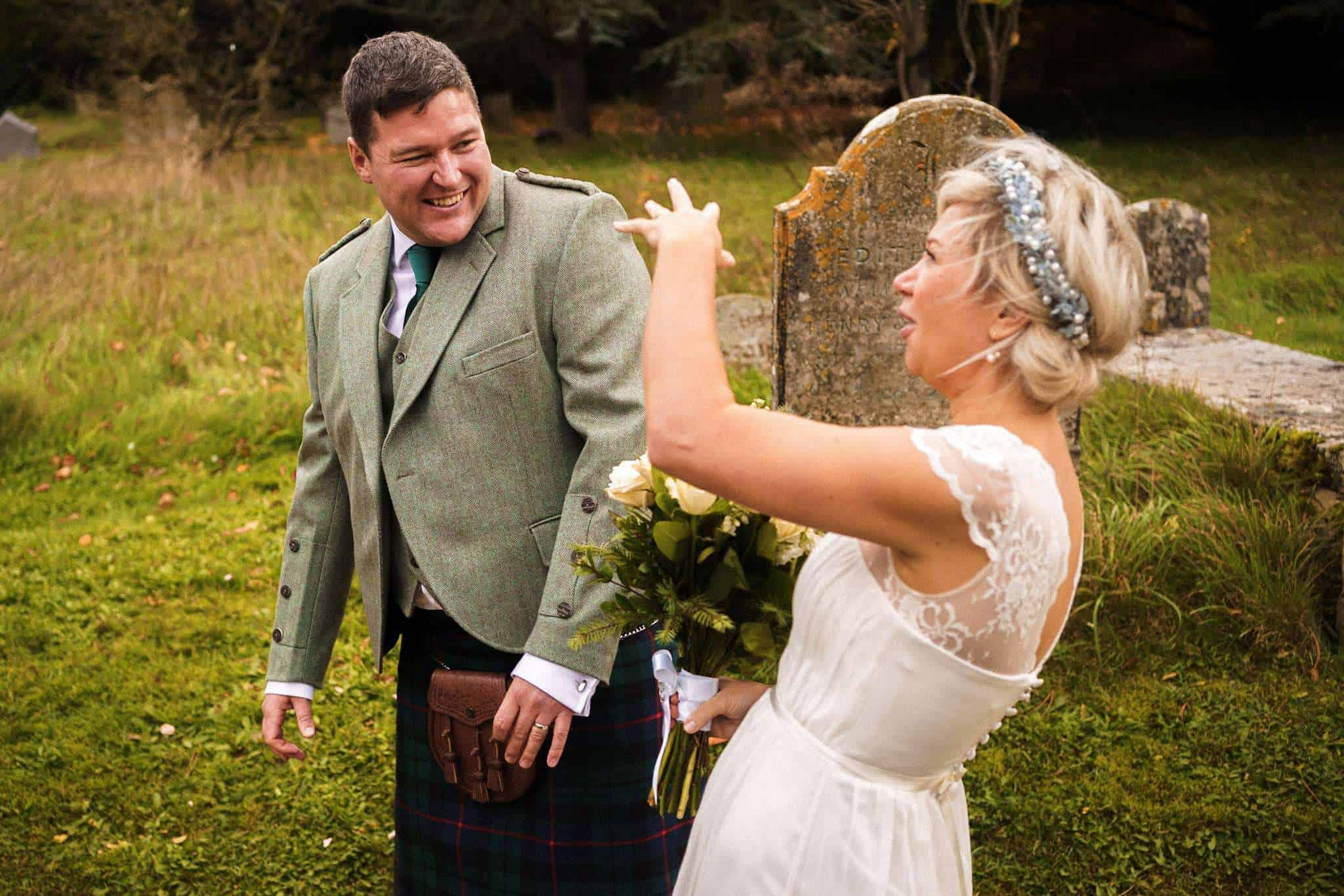 A bride and groom share a joke after just getting married
