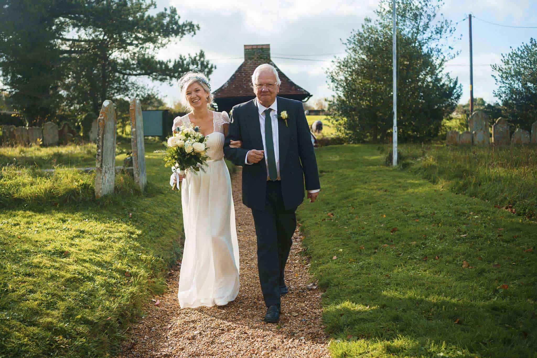 A bride arriving at the church with her father