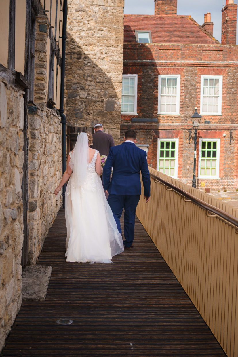 A bride & groom walking together hand in hand