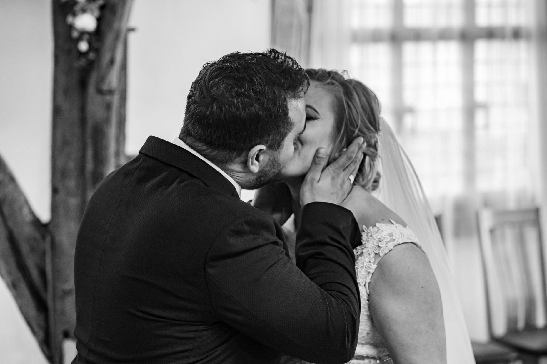 A bride & groom share their first kiss at Westgate Hall