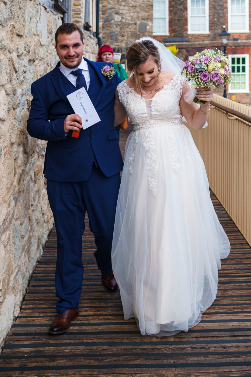 A bride and groom after just getting married at Westgate Hall